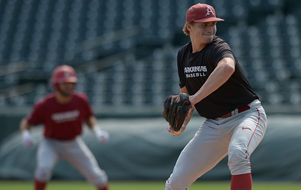 Arkansas pitcher Jake Reindl delivers to the plate Tuesday, Sept. 5, 2017, during fall practice at Baum Stadium in Fayetteville.
