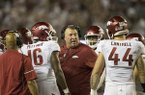 Arkansas coach Bret Bielema talks to players during a game against Alabama on Saturday, Oct. 14, 2017, in Tuscaloosa, Ala.