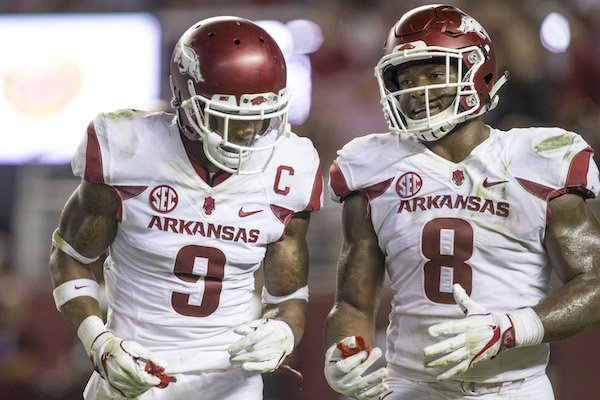 Arkansas safety Santos Ramirez (left) and linebacker De'Jon Harris talk during a 41-9 loss at Alabama Saturday, Oct. 14, 2017, at Bryant-Denny Stadium in Tuscaloosa, Ala.