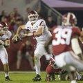 Arkansas quarterback Cole Kelley scrambles while looking downfield in a 41-9 loss at Alabama Saturda...