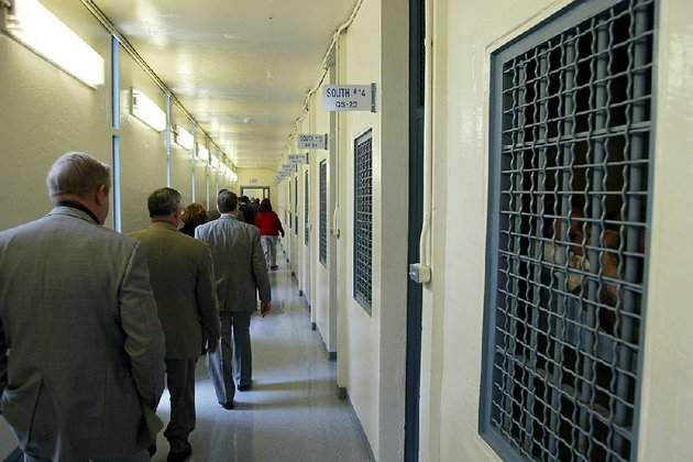 in-this-december-2002-photo-prison-board-members-and-other-officials-view-the-isolation-wing-at-the-cummins-unit-at-varner-the-arkansas-department-of-correction-wants-to-add-up-to-400-more-lockdown-cells-to-the-more-than-2000-already-in-use