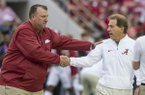 Arkansas coach Bret Bielema, left, shakes hands with Alabama coach Nick Saban prior to a game Saturday, Oct. 14, 2017, in Tuscaloosa, Ala.