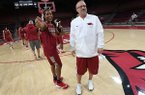 Arkansas coach Mike Neighbors, right, is shown with senior guard Devin Cosper during the Razorbacks' media day on Monday, Oct. 16, 2017, in Fayetteville.