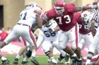 Arkansas offensive lineman Shawn Andrews (73) makes a block during a game against Auburn on Saturday, Oct. 11, 2003, in Fayetteville.