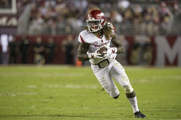 Arkansas receiver Brandon Martin runs after a catch during a game against Alabama on Saturday, Oct. 14, 2017, in Tuscaloosa, Ala.