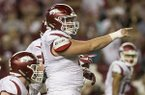 Arkansas center Zach Rogers calls out a play during a game against Alabama on Saturday, Oct. 14, 2017, in Tuscaloosa, Ala.