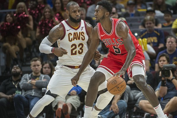 Cleveland Cavaliers' LeBron James (23) guards Chicago Bulls' Bobby Portis (5) during an NBA preseason basketball game in Cleveland, Tuesday, Oct. 10, 2017. (AP Photo/Phil Long)