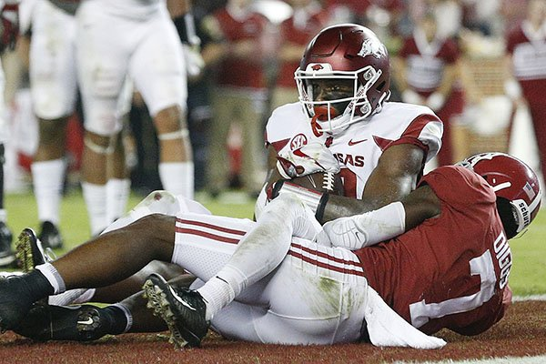 Arkansas wide receiver Jordan Jones scores a touchdown against Alabama defensive back Trevon Diggs during the second half an NCAA college football game, Saturday, Oct. 14, 2017, in Tuscaloosa, Ala. (AP Photo/Brynn Anderson)