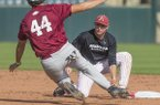 Arkansas shortstop Jax Biggers tags base runner Derek Ripp during a scrimmage Wednesday, Oct. 11, 2017, in Fayetteville.