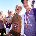 Members of the Fayetteville girls tennis team pose with the trophy after winning the Class 7A team t...
