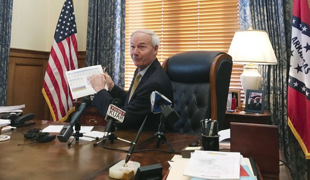 arkansas-gov-asa-hutchinson-speaks-to-reporters-tuesday-at-the-state-capitol-in-little-rock-hutchinson-spoke-about-the-trump-administration-ending-a-subsidy-under-the-federal-health-overhaul-hutchinson-said-the-states-hybrid-medicaid-expansion-wont-be-jeopardized-by-double-digit-insurance-rate-increases-that-were-approved-on-response-to-the-subsidies-elimination-ap-photoandrew-demillo