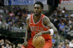 Chicago Bulls' Bobby Portis (5) handles the ball during a preseason NBA basketball game against the Dallas Mavericks on Wednesday, Oct. 4, 2017, in Dallas. (AP Photo/Tony Gutierrez)
