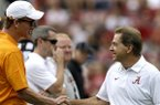 Alabama head coach Nick Saban, right, shakes hands with former Tennessee and current NFL quarterback, Peyton Manning, before the first half of an NCAA college football game, Saturday, Oct. 23, 2015, in Tuscaloosa, Ala. (AP Photo/Butch Dill)