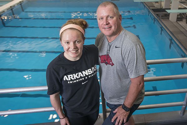 Arkansas freshman diver Brooke Schultz, left, is earning high marks for her father, Razorbacks coach Dale Schultz.