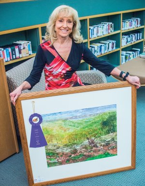 Charlotte Rierson of Fairfield Bay won Best of Show in the Conway League of Artists Fall Show, on display at the Faulkner County Library in Conway. She won the honor with her painting Beyond My Garden — Greers Ferry Lake
