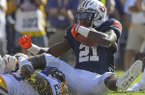 Auburn running back Kerryon Johnson (21) rushes against LSU linebacker Corey Thompson (23) in the first half during an NCAA college football game in Baton Rouge, La., Saturday, Oct. 14, 2017. (AP Photo/Matthew Hinton)