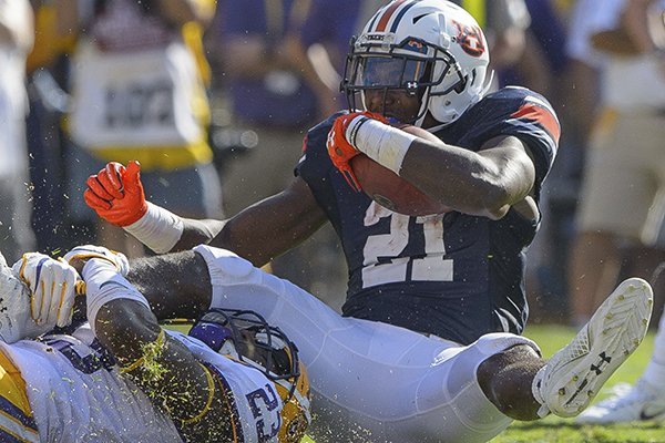 auburn-running-back-kerryon-johnson-21-rushes-against-lsu-linebacker-corey-thompson-23-in-the-first-half-during-an-ncaa-college-football-game-in-baton-rouge-la-saturday-oct-14-2017-ap-photomatthew-hinton