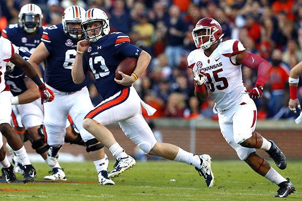 Auburn quarterback Sean White (13) scrambles for a run as Arkansas linebacker Dwayne Eugene (35) gives chase during the first half of an NCAA college football game against Arkansas, Saturday, Oct. 22, 2016, in Auburn, Ala. (AP Photo/Butch Dill)