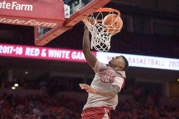 Arkansas forward Darious Hall dunks the ball in transition Friday, Oct. 20, 2017, during the second half of play in Bud Walton Arena.