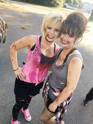 Kim Ferguson, left, and Kala West participate in last year's zombie parade in Heber Springs.