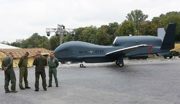 german-soldiers-stand-near-the-used-nato-drone-that-has-been-purchased-by-north-little-rock-the-global-hawk-block-40-will-be-operational-by-the-end-of-the-monthfayetteville-born-otus-the-head-cats-award-winning-column-of-humorous-fabrication-appears-every-saturday