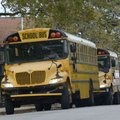 A row of buses wait Friday in front of Washington Elementary School in Fayetteville as students boar...