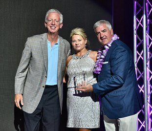 Submitted photo WONDER WALL: Donya Catlett-Vise, center, who is working to create Ali's Wonderland in Hot Springs in honor of her daughter, was honored recently at the Free to Soar fundraiser gala in San Antonio by Gordon Hartman, left, co-founder of Morgan's Wonderland, and Ron Morander, right, general manager of the park. Catlett-Vise was added to the park's Wall of Fame.