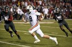 Auburn quarterback Jarrett Stidham (8) runs past the Arkansas defense to score a touchdown in the first half of an NCAA college football game in Fayetteville, Ark., Saturday, Oct. 21, 2017. (AP Photo/Michael Woods)