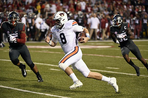 Auburn quarterback Jarrett Stidham (8) runs past the Arkansas defense to score a touchdown in the first half of an NCAA college football game in Fayetteville, Ark., Saturday, Oct. 21, 2017. (AP Photo/Michael Woods)