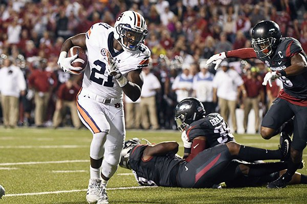 auburn-running-back-kerryon-johnson-left-runs-around-the-arkansas-defense-to-score-a-touchdown-in-the-first-half-of-an-ncaa-college-football-game-in-fayetteville-ark-saturday-oct-21-2017-ap-photomichael-woods