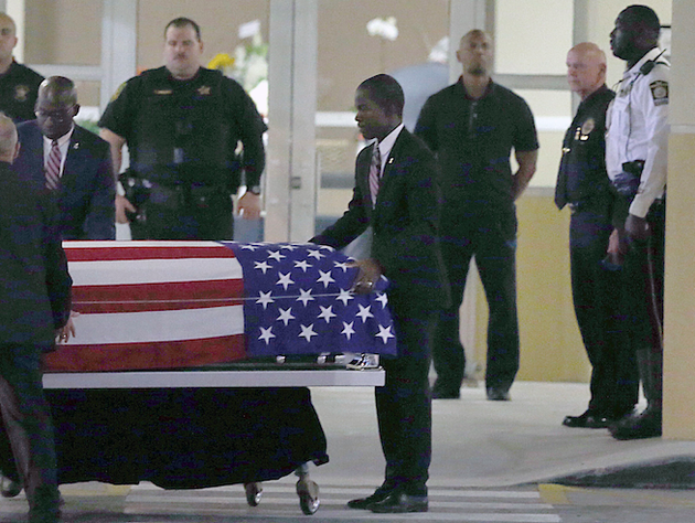 the-casket-of-sgt-la-david-t-johnson-of-miami-gardens-who-was-killed-in-an-ambush-in-niger-is-wheeled-out-after-a-viewing-at-the-christ-the-rock-church-friday-oct-20-2017-in-cooper-city-fla-pedro-portalmiami-herald-via-ap