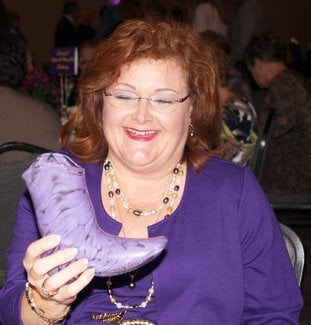 The Glass Boot: Mary Pat Cook Anthony shows the glass boot she received as the 2017 'Stepping Up for Ouachita' honoree at a luncheon Thursday. The event is held annually to honor an alumna of Ouachita Baptist University and raise funds to provide scholarships for female students to attend OBU. See more photos on page 8A.