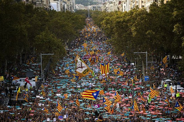 people-flood-the-streets-of-barcelona-spain-on-saturday-in-what-began-as-a-protest-against-the-jailing-of-pro-independence-activists-and-turned-into-an-outcry-over-the-central-governments-move-to-take-over-the-catalonia-region
