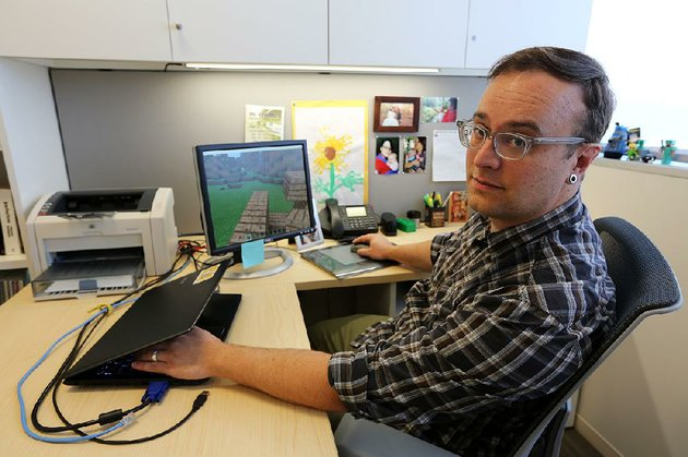 mark-barnes-a-professor-at-the-university-of-arkansas-pulaski-technical-college-uses-the-video-game-minecraft-to-demonstrate-urban-planning-to-people-in-other-countries