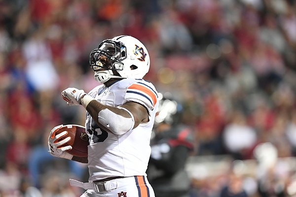 Auburn running back Kamryn Pettway scores a touchdown during a game against Arkansas on Saturday, Oct. 21, 2017, in Fayetteville.