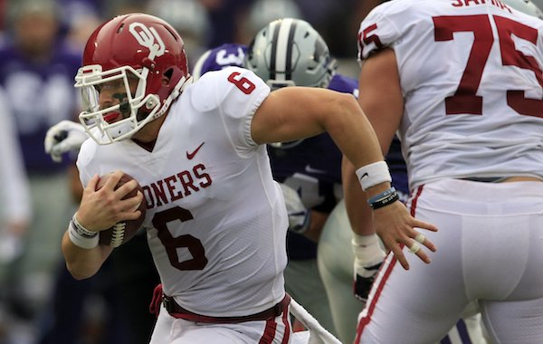 Oklahoma quarterback Baker Mayfield (6) breaks away for a 34-yard run during the first half of an NCAA college football game against Kansas State in Manhattan, Kan., Saturday, Oct. 21, 2017. (AP Photo/Orlin Wagner)