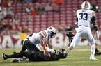 Arkansas quarterback Cole Kelley is tackled by an unidentified Auburn defender on Saturday, Oct. 21, 2017, in Fayetteville.