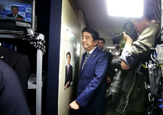 japanese-prime-minister-shinzo-abe-leader-of-the-liberal-democratic-party-arrives-at-the-party-headquarters-in-tokyo-on-sunday-for-ballot-counting-in-elections-to-japans-lower-house-of-parliament