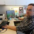 Mark Barnes, a professor at the University of Arkansas-Pulaski Technical College, uses the video gam...