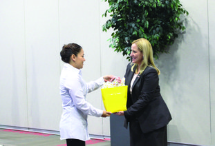 Arkansas Attorney General Leslie Rutledge, right, accepts a gift from South Arkansas Community College student Dee Guzman, president of the Phi Beta Lambda chapter, at an event Monday. Rutledge spoke about cyber security, identity theft and internet safety as part of the first annual SouthArk CyperExpo.