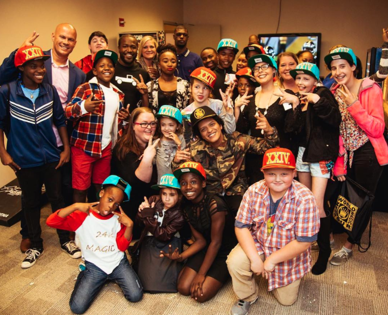 Photo bruno mars meets with north little rock children donates bruno mars poses with north little rock children and officer tommy norman before his verizon arena show on sunday night photo courtesy tommy norman m4hsunfo