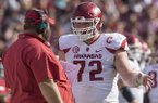 Arkansas offensive lineman Frank Ragnow talks with offensive line coach Kurt Anderson during a game against South Carolina on Saturday, Oct. 7, 2017, in Columbia, S.C.