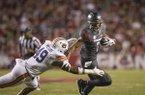 Jonathan Nance, Arkansas wide receiver, tries to break the tackle of Darrell Williams, Auburn linebacker, in the first quarter Saturday, Oct. 21, 2017, at Reynolds Razorbacks Stadium in Fayetteville.