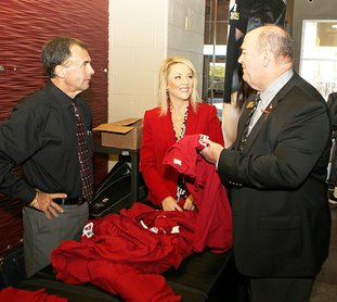The Sentinel-Record/Richard Rasmussen REDDIES FOR WOLVES: Lake Hamilton Superintendent Steve Anderson, right, greeted Henderson State University Provost Steve Adkison, left, and Brandie Benton, associate provost for enrollment services and admissions, Monday morning in Lake Hamilton Wolf Arena for the announcement of the Wolf Reddie Scholarship. The award will be available to honor graduates from Lake Hamilton High School to fill any gaps left between their other financial aid and scholarships.