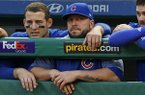 Chicago Cubs' Anthony Rizzo, left, and coach Eric Hinske watch the top of the ninth inning from the dugout during a baseball game against the Pittsburgh Pirates in Pittsburgh, Monday, Sept. 4, 2017. The Pirates won 12-0. (AP Photo/Gene J. Puskar)