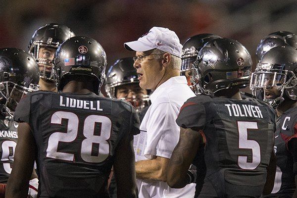 Arkansas defensive coordinator Paul Rhoads is surrounded by players during the Razorbacks' 52-20 loss to Auburn on Saturday, Oct. 21, 2017, in Fayetteville.