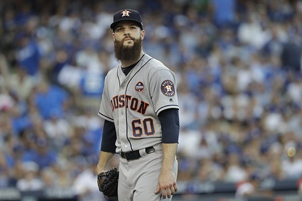 Houston Astros starting pitcher Dallas Keuchel walks back to the dugout after the first inning of Game 1 of baseball's World Series against the Los Angeles Dodgers Tuesday, Oct. 24, 2017, in Los Angeles. (AP Photo/David J. Phillip)