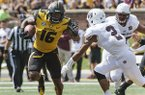 Missouri running back Damarea Crockett, left, runs past Missouri State cornerback Darius Joseph, right, during the third quarter of an NCAA college football game Saturday, Sept. 2, 2017, in Columbia, Mo. Missouri won the game 72-43. (AP Photo/L.G. Patterson)