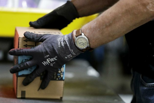 an-employee-packages-a-product-at-an-amazon-warehouse-in-robbinsville-township-nj-in-august-amazon-said-wednesday-that-it-is-offering-a-new-service-that-allows-employees-to-drop-packages-off-inside-customers-homes