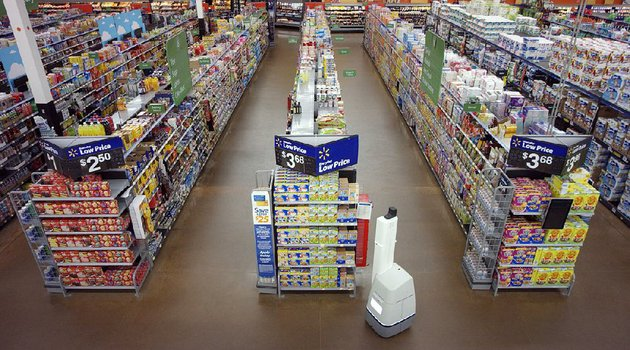a-robot-prowls-the-aisles-of-a-wal-mart-store-in-a-test-run-of-the-autonomous-devices-mission-to-check-shelves-and-alert-workers-to-stocking-or-pricing-needs